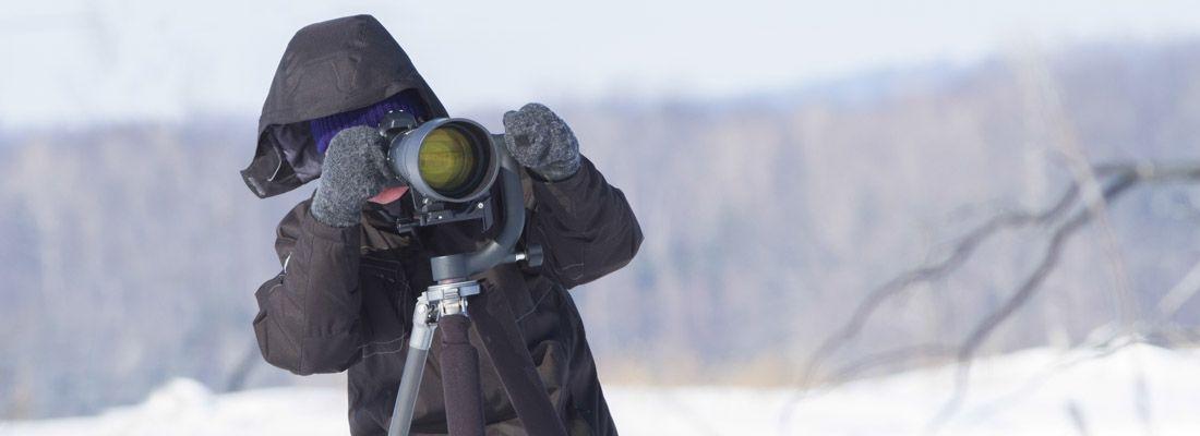 Un fotografo sulla neve.