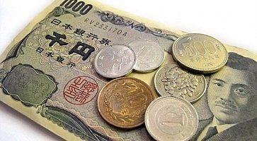 Banconota da 1000 yen e varie monete giapponesi.