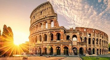 sunrise behind Colosseum in Rome Italy