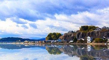 Kitsuki, Oita prefecture, Japan-12 Jan: The reflex of Kitsuki town on an ocean in Japan, 12 Jan 2016