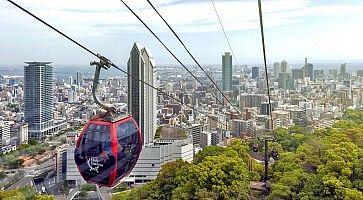 Kobe, Japan - April 2016: Kobe cityscape and skyscraper seen from ropeway to Nunobiki Herb Garden on Mount Rokko in Kobe, Japan