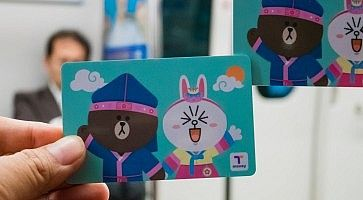Hand holding T-Money card with Line characters